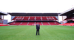 FILE PHOTO: Arsene Wenger is to leave Arsenal at the end of the season, ending a near 22-year reign as manager<br /><br />The New Arsenal Manager Arsene Wenger pictured in the middle of the pitch at Highbury  ... Soccer - Arsenal New Manager - Arsene Wenger - Highbury Stadium ... 22-09-1996 ... Dortmund ... Deutschland ... Photo credit should read: Aubrey Washington/EMPICS Sport. Unique Reference No. 198986 ... Motor racing, Portuguese Grand Prix.<br />Johnny Herbert leads <br />Rubens Barrichello