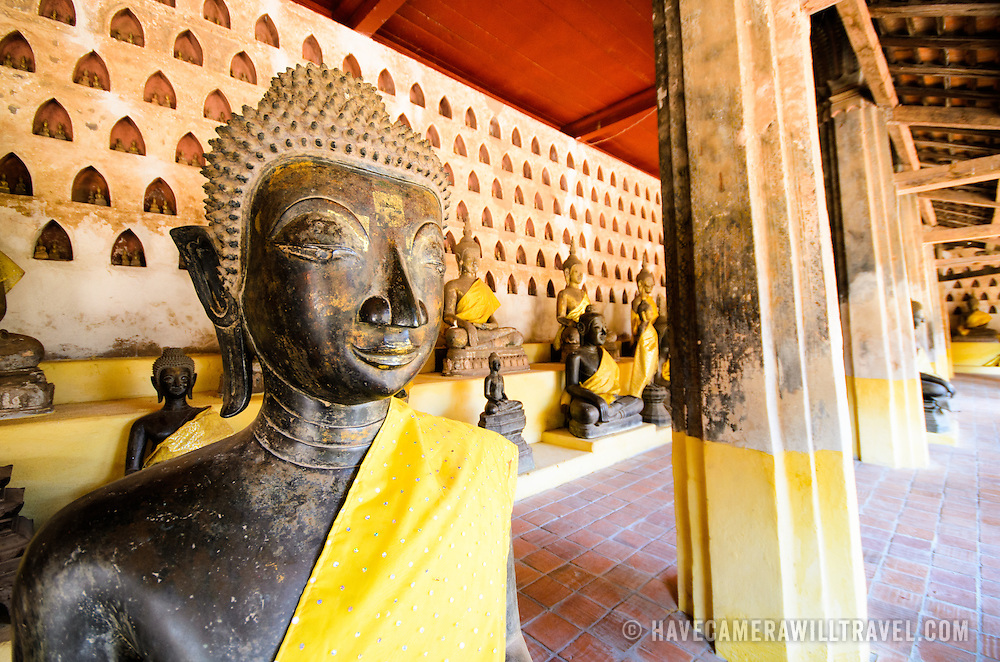 Part of a collection of approximately 2000 ceramic and silver buddhas on display in the cloisters at Wat Si Saket in Vientiane, Laos. Built in 1818, the temple is of the Siamese style rather than the traditional Lao style. It is now perhaps the oldest temple still standing in Vientiane.