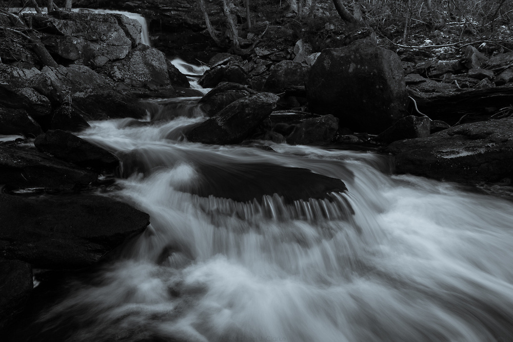 Mountain water sliding through Doane's Falls on a cold autumn evening.