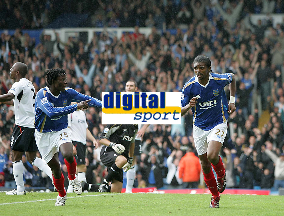 Photo: Lee Earle.<br /> Portsmouth v Bolton Wanderers. The FA Barclays Premiership. 18/08/2007.Portsmouth's Benjani (L) goes to congratulate Kanu (R) after he scored their first goal.