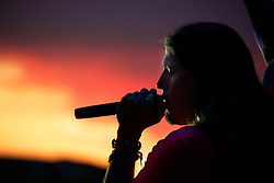 Jason Michael Carroll sings into a Napoli sunset at a Concert in Naples Italy