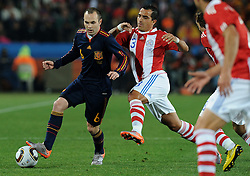 03.07.2010, Ellis Park, Johannesburg, RSA, FIFA WM 2010, Viertelfinale, Paraguay (PAR) vs Spanien (ESP) im Bild Andres Iniesta (Spagna) vs Claudio Morel (Paraguay), EXPA Pictures © 2010, PhotoCredit: EXPA/ InsideFoto/ Perottino, ATTENTION! FOR AUSTRIA AND SLOVENIA ONLY! / SPORTIDA PHOTO AGENCY