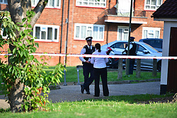 © Licensed to London News Pictures. 15/09/2016. London, UK. Police attend the scene of a double shooting in a block of flats in East Finchley. Police were called by London Ambulance Service at 06:25hrs this morning to reports of two people injured at an address in north London. A man and a woman were found with gunshot injuries. Both were pronounced dead at the scene. Photo credit: Ben Cawthra/LNP