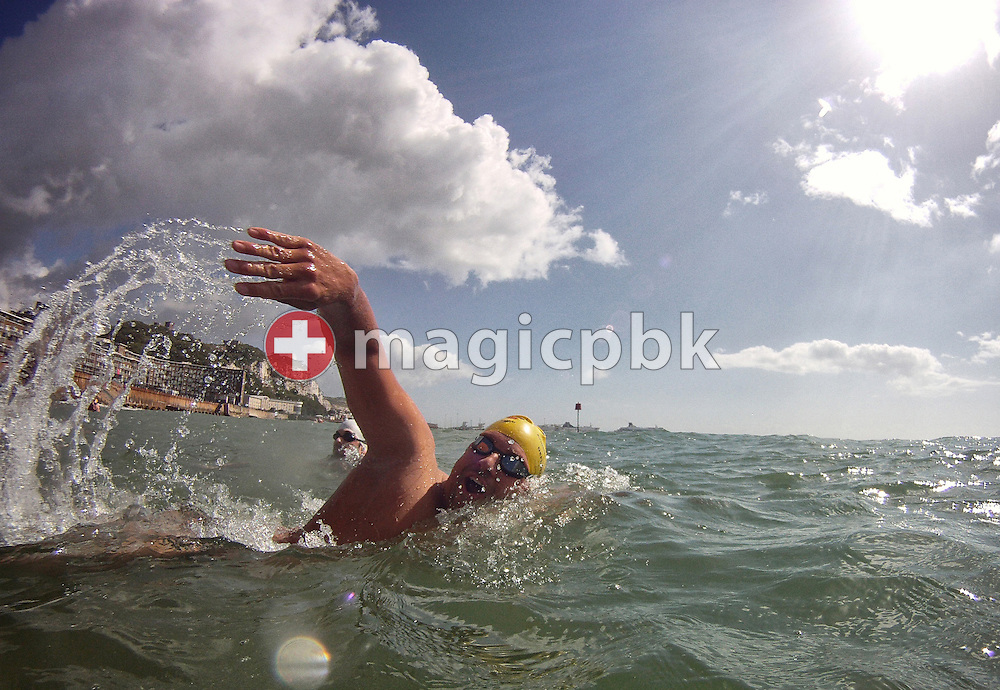 Gino Deflorian of Switzerland swims during a training session in the sea at the harbour in Dover, Great Britain, Sunday, Aug. 18, 2013. Gino Deflorian tries to become the first Swiss male swimmer who successfully swims the English Channel form Dover/Folkestone to Calais, France. (Photo by Patrick B. Kraemer / MAGICPBK)