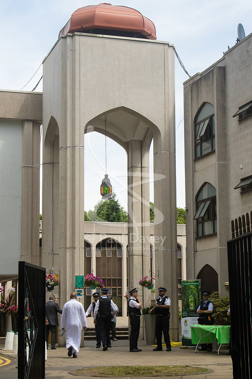 London, June 23rd 2017. Police are in evidence as Muslim worshippers gather for Friday Prayers at London Central Mosque in Regents Park, following the suspected terror attack in the early Hours of Monday June 19th when Darren Osbourne, 47, from Cardiff, now charged with terrorism-related murder, is alleged to have run down a group of Muslims in Finsbury Park. PICTURED: Police and community support officers hand on tackling hate crime as worshipers arrive for Prayers..