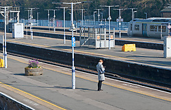 ©Licensed to London News Pictures 26/03/2020<br /> Orpington, UK. A lone commuter. Empty station platforms this morning at Orpington train station in Orpington, South East London. The Prime Minister Boris Johnson has asked people to stay at home to help in the fight against Covid-19. Photo credit: Grant Falvey/LNP