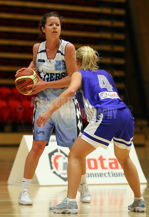PERTH, AUSTRALIA - JULY 16: Kate Malpass of the Tigers looks to pass around Tanya Kelly of the Hawks during the week 18 SBL game between the Perry Lakes Hawks and the Willetton TIgers at The State Basketball Center on July 16, 2011 in Perth, Australia.  (Photo by Paul Kane/All Sports Photography)