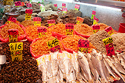 Shop selling dried fish and other seafood in Wan Chai's thronging food market on Bowrington Road in Hong Kong, China. Almost any food can be bought here, both fresh or cooked. Wan Chai is a busy Chinese shopping district totally different to nearby westernised Central.