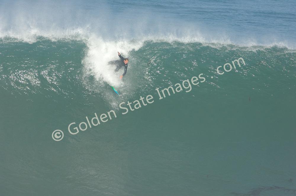 Surfer goes over the falls, 1 of 4 frames.