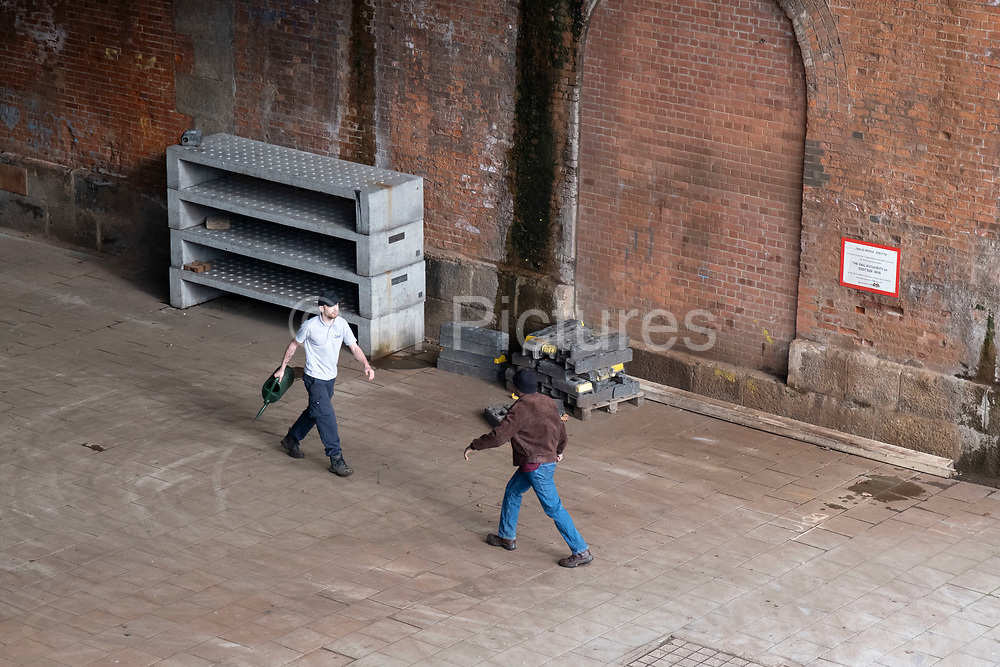 Two men having an altercation on the South Bank on 5th March 2021 in London, England, United Kingdom. The disagreement, which started when the man in white threw water onto the man in the brown jacket for urinating behind a bush. They went on to have a fight and security were called.
