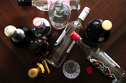 File photo dated 22/04/15 of empty bottles of alcohol, as drinking more than the recommended weekly limits can harm a person's brain health, a new study has found.