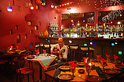 An Armenian-Lebanese singer plays music before the crowds come to the Spanish restaurant La Solea, in the Christian neighborhood of Ashrafieh in Beirut, Lebanon, March 30, 2006.