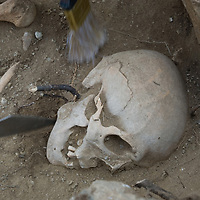 Archaeologists from the Smithsonian Museum unearth a Bronze-age skeleton at a site near Muren, Mongolia. These bones may be 2700+ years old.
