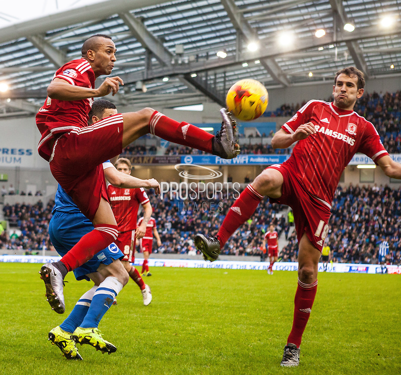 Middlesbrough FC midfielder Emilio Nsue & Middlesbrough FC striker Christian Stuani beat Brighton player Jamie Murphy to the ball during the Sky Bet Championship match between Brighton and Hove Albion and Middlesbrough at the American Express Community Stadium, Brighton and Hove, England on 19 December 2015. Photo by Bennett Dean.