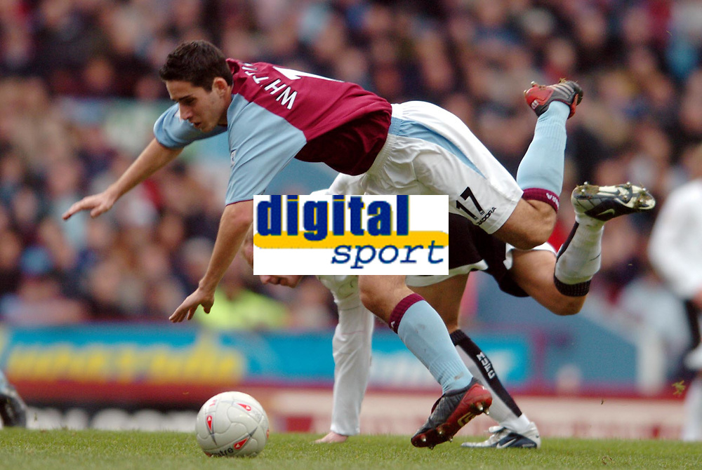 Photo. Matthew Lewis.<br /> Aston Villa v Manchester United. FA Cup 3rd Rd. 04/01/2004.<br /> <br /> Aston Villa's Peter Whittingham is tackled by Manchester's Nicky Butt.