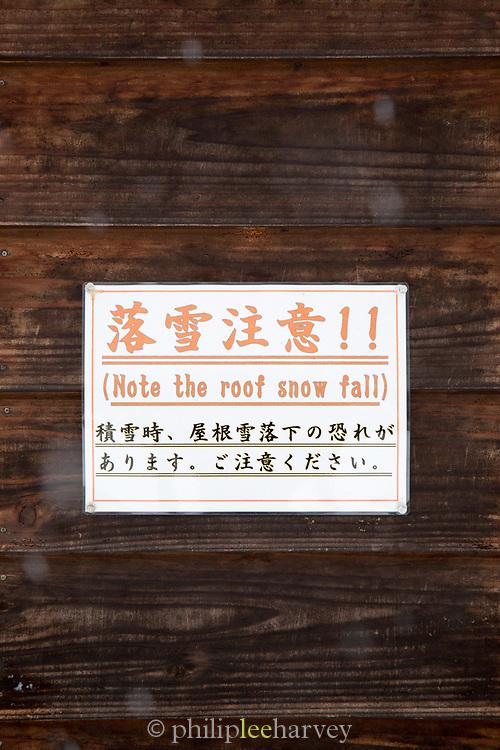 Warning sign for snow falling off roofs, Shirakawa-go, Japan