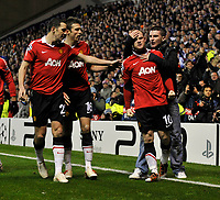 Ibrox Park Glasgow Rangers v Manchester United Champions League Group  C  24/11/2010<br /> Wayne Rooney (Man Utd) is grabbed by a fan  celebrates after scoring from penalty<br /> Photo: Roger Parker Fotosports International