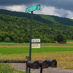Bellville, PA, USA - May 23, 2013: A sign offering fresh butter for sale on an Amish farm on Raspberry Lane, a rural road near Belleville in Kishacoquillas Valley, Mifflin County, PA.