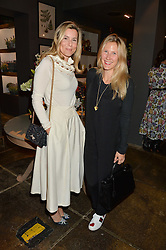 Left to right, ALEX GORE-BROWN and LEONORA BAMFORD at a party to celebrate the publication of Flourish by Willow Crossley held at OKA, 155-167 Fulham Rd, London on 4th October 2016.