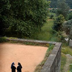 Santa Maria Do Bourho, Portugal - Nuns visiting the former Cistercian monastery of Santa Maria Do Bourho chat on one of the terraces of the building...Photo by Susana Raab