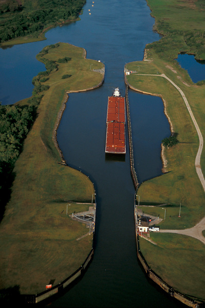 Aerial view of a barge navigating through the Port of Houston