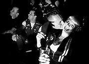 May 14, 2009-Denver, Colorado, USA-Michael Sumption kisses his wife Jessica as she laughs at the at the wrestlers of the Micro Wrestling Federation at 3 Kings Tavern. (Credit Image: Bret Hartman/Zuma Press)