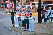 Supporters of US President Bill Clinton welcome his campaign during a campaign stop on their bus tour August 31, 1996 in Cape Girardeau. MO.