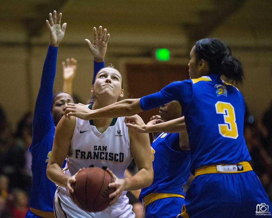San Francisco Lady Dons forward Michaela Rakova (14) takes the ball to the basket against the San Jose State Spartans at Kezar Pavilion in San Francisco, Calif., on December 6, 2016. (Stan Olszewski/Special to S.F. Examiner)
