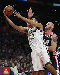 November 10, 2018 - Los Angeles, California, U.S - Malcolm Brogdon #13 of the Milwaukee Bucks goes for a layup past Marcin Gortat #13 of the Los Angeles Clippers during their NBA game on Saturday November 10, 2018 at the Staples Center in Los Angeles, California. Clippers defeat Bucks in OT, 128-126. (Credit Image: © Prensa Internacional via ZUMA Wire)