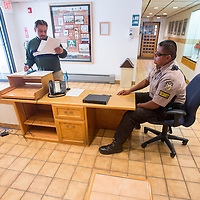 102313       Brian Leddy<br /> Red Rock Security and Patrol employee Darrick Lilly mans the security desk at Gallup City Hall Wednesday. The city recently hired a security patrol after a rash of incidents in recent weeks.