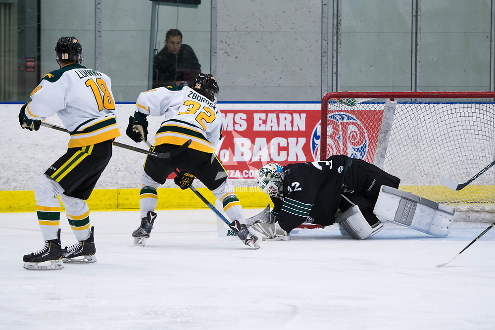 1st year forward Zak Zborosky (32) of the Regina Cougars in action during the Men's Hockey Home Opener on October 6 at Co-operators arena. Credit: Arthur Ward/Arthur Images