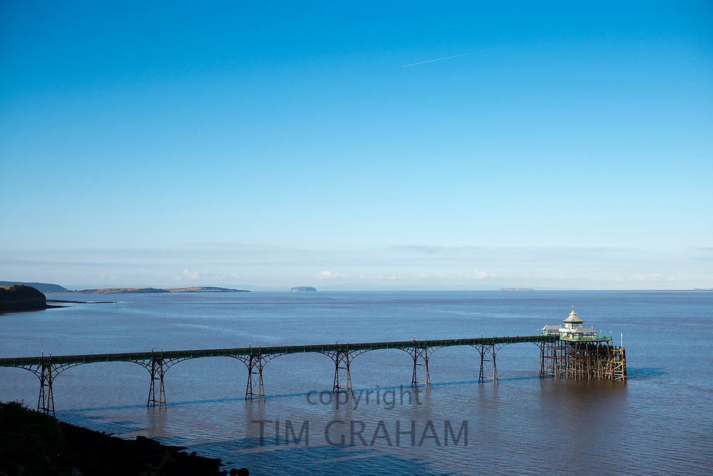The ancient Victorian pier on stilts on east shore of the Severn Estuary at Clevedon in Somerset, West Coast UK