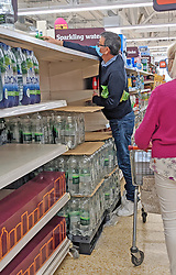 © Licensed to London News Pictures 20/09/2021. <br /> Sevenoaks, UK, A customer having to reached to the back of an empty shelf for his Sparkling bottles of water at Sainsburys in Sevenoaks, Kent today. Supermarket shortages are continuing across the UK due to a lack of supply and a shortage of lorry drivers which is expected to get a lot worse over the next few months. Photo credit:Grant Falvey/LNP