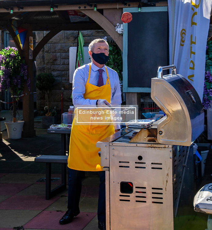 Pictured: <br />Scottish Liberal Democrat Leader Willie Rennielauched his party's manifesto today during a vistb to the Broadwalk Cafe in Edinburgh today.<br />Ger Harley   EEm 16 April 2021