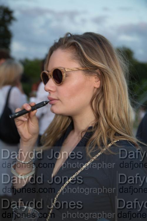 KEELEY WALKER SMOKING ELECTRIC CIGARETTE,  CHARLES FINCH'S CHUCS SWIMATHON 2013, SERPENTINE, Hyde Park, London. 4 July 2013.