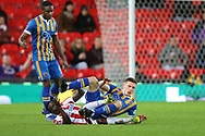 8 Greg Docherty for Shrewsbury Town and Peter Etebo for Stoke City during the The FA Cup 3rd round replay match between Stoke City and Shrewsbury Town at the Bet365 Stadium, Stoke-on-Trent, England on 15 January 2019.