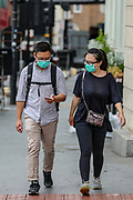 Some people appear to be wearing surgical protective masks in Central London on Saturday, July 4, 2020. Pubs, restaurants, places of worship and other businesses reopen their doors across the UK on 04 July after more than three months of lockdown due to coronavirus pandemic outbreak which claimed lives of over 65,000 people in Britain. (VXP Photo/ Vudi Xhymshiti)