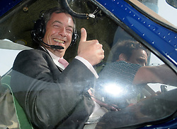 © under license to London News Pictures. 7/12/13 A pilot who was at the controls of a plane that crashed injuring UKIP leader Nigel Farage has been found dead.<br /> <br /> FILE PICTURE  © under license to London News Pictures. 01/12/2010 Pictured: Nigel Farage (L) and Justin Adams (R) photographed a week before the flight which crashed. Justin Adams, the pilot of the plane which crashed and injured Nigel Farage has been charged with threatening to kill the politician. Picture credit should read Stephen Simpson/London News Pictures