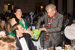 Old Town Hall, Stratford, London - 28 November 2015. Singers Marc Almond, Ronan Parke, Heather Peace and Asifa Lahore headline the Peter Tatchell Foundation's inaugural Equality Ball, a fundraiser for the foundation's LGBTI and human rights work, with guest of honour Sir Ian McKellen  joined by Paul O'Grady, Rupert Everett and Michael Cashman. PICTURED:  Sir Ian McKellen draws a raffle ticket.  //// FOR LICENCING CONTACT: paul@pauldaveycreative.co.uk TEL:+44 (0) 7966 016 296 or +44 (0) 20 8969 6875. ©2015 Paul R Davey. All rights reserved.