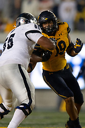 California outside linebacker Cameron Goode (19) tries to fight through the block of Nevada tackle Aaron Frost (65) during the fourth quarter of an NCAA college football game, Saturday, Sept. 4, 2021, in Berkeley, Calif. (AP Photo/D. Ross Cameron)