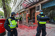 Police form a line around the Office of Israeli arms company, Elbit System in London on Saturday, Oct 10, 2020, after a group of Palestinian protestors pelted it in red colour (resembling blood). Elbit Systems openly market their weapons as 'field-tested' on Palestinian civilians in Gaza. (VXP Photo/ Vudi Xhymshiti)