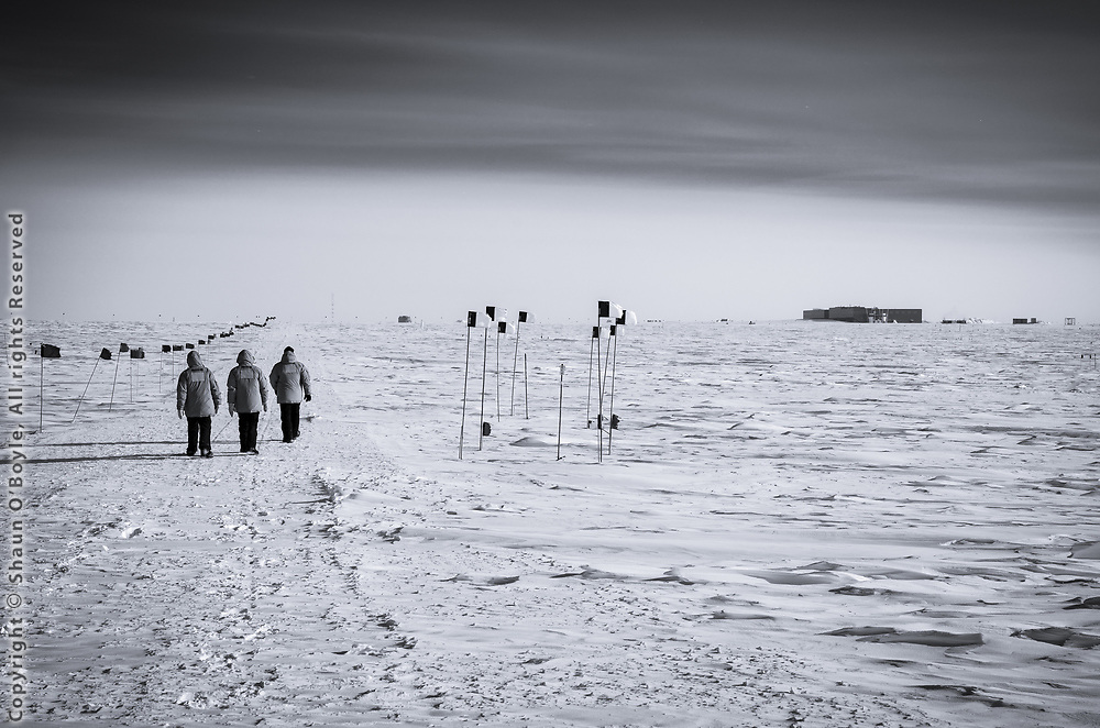 Amundsen-Scott South Pole Station in the distance during the 1 kilometer walk from IceCube Laboratory.