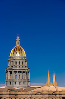 Colorado State Capitol dome and spires of Church of Immaculate Conception on right, Downtown Denver, Colorado USA.