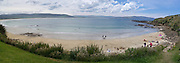 People swim, sunbathe, kayak and relax at Porpoise Bay, Catlins, Clutha, New Zealand.