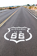 Historic Route 66 sign painted on the pavement.