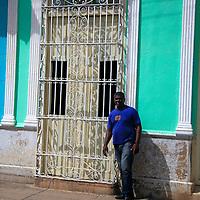Central America, Cuba, Trinidad. Cuban man and door in Trinidad.