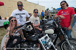 Tara Cheuvront on her Harley-Davidson Shovelhead with friends at the Biltwell Bash at Robison's Cycles during the Daytona Bike Week 75th Anniversary event. FL, USA. Friday March 11, 2016.  Photography ©2016 Michael Lichter.