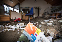 © Licensed to London News Pictures. 08/12/2015. Glen ridding UK. Picture shows whats left of the tourist information centre in Glenridding. The village of Glenridding has been cut of from the outside world for four days with no water, electricity or telephone lines after huge torrents of water from the surrounding mountains destroyed roads leading to it & flooded the village centre. Photo credit: Andrew McCaren/LNP