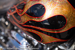 Gold leaf and flames detail on a custom bike in the Cycle Source show at the Iron Horse Saloon during the annual Sturgis Black Hills Motorcycle Rally. SD, USA. Thursday August 10, 2017.  Photography ©2017 Michael Lichter.