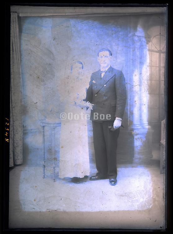 deteriorating wedding portrait in studio with classic interior background France circa 1920s